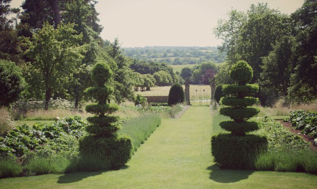 The view from the central, axial, path in the early 18th-century gardens at Canons Ashby. The gardens were described in Alicia Amherst's History of Gardening (1895) and H Inigo Triggs's Formal Gardens in England and Scotland (1902), which  influenced  a generation of garden designers.  Registered Grade II*.