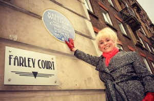 Actress Barbara Windsor with a newly installed English Heritage Blue Plaque marking the life of comic actor, Kenneth Williams