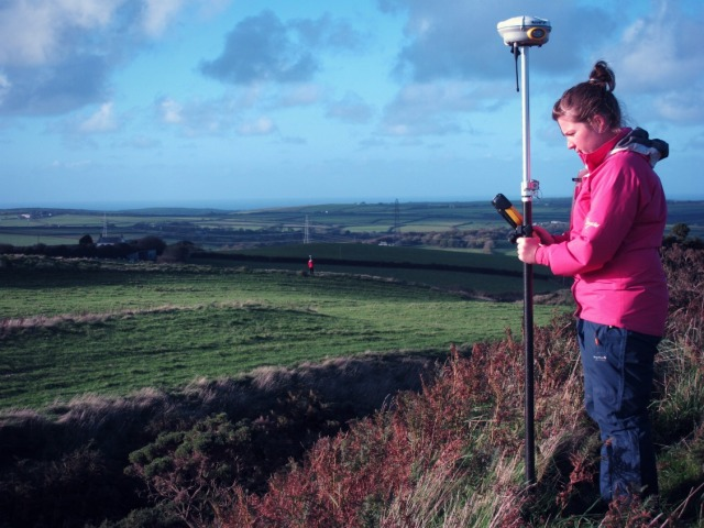 Zoe and Elaine conducting GPS survey at Warbstow Bury, taken from the inner rampart. Note the entrance terminal of the middle rampart in front of Elaine, who is on the outer rampart in the background. Photograph by Mark Bowden © English Heritage