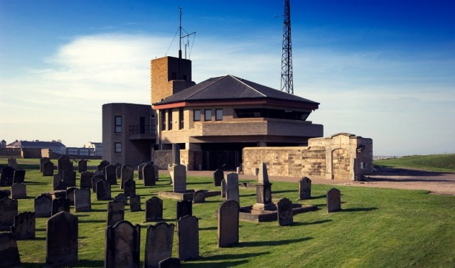 By the end of the 20th century Coastguard stations had evolved into Marine Rescue Centres, their altered role was reflected in their different architectural treatment. This sub-centre at Tynemouth Priory, North Tyneside was designed by the Property Services Agency and opened in 1980