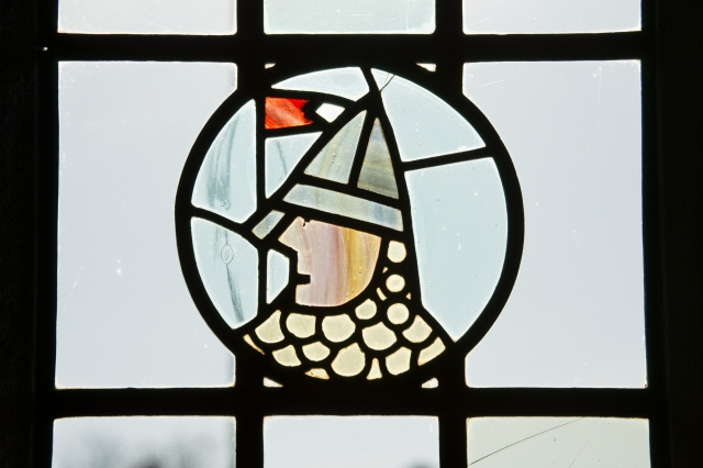 A stained glass window in The Gatehouse, Norwich, built in 1934, now listed at Grade II © Historic England/ Pat Payne Ref: DP172341