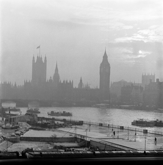 the houses of parliament, westminster abbey and westminster bridge, seen across the river thames from the north-east, with a light covering of snow in the foreground photograph out of focus. palace of westminster greater london city of westminster westminster