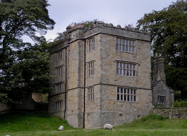 North Lees Hall, Derbyshire, listed Grade II*. In 1845 Charlotte visited the ancestral home of the Eyre family, who inspired the name of Charlotte's first heroine. Here she learned of a mad woman who had once been kept in an upstairs room, giving her the inspiration for Mr Rochester's Thornfield Hall in her first and most famous novel Jane Eyre. (c) Dave Bevis via Wikimedia Commons