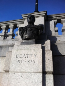 Commemorative bronze busts of Admiral Beatty by William McMillan and Sir Charles Wheeler on the north side of Trafalgar Square. © Historic England