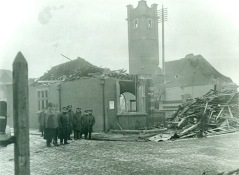 Firemen and police outside the ruins of Silvertown fire station. Image courtesy Newham Archives & Local Studies Library.