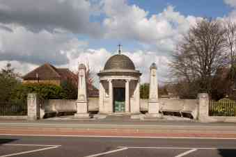 Bedfordshire and Hertfordshire War Memorial, Kempston, Bedfordshire. Designed by local architect George P. Allen. Unveiled 11 November 1921. Upgraded to Grade II*. © Historic England DP182315. The memorial is in Neo-classical style with a circular temple whose dome is encircled with the words: THEIR NAME LIVETH FOR EVER MORE. A Roll of Honour rests within on an oak altar. It was erected to commemorate the 6,081 men of the Bedfordshire Regiment (renamed in 1919 the Bedfordshire and Hertfordshire Regiment) killed in action in the First World War or who died of injury or illness. Originally they were remembered on a central obelisk that included on its pedestal a list of their theatres of war, including Ypres. This obelisk was moved to the left in 1950 and a matching one installed to the right in commemoration of the 1,074 men of the two Regiments who fell in World War Two.
