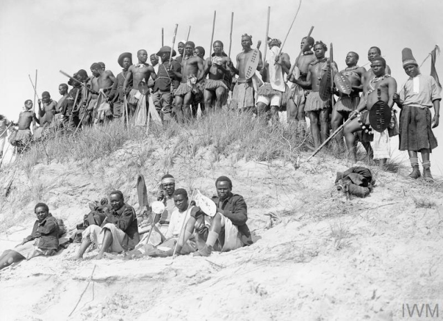 Members of the SANLC preparing for a Zulu war dance