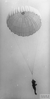 An observer from an observation balloon descending by parachute © IWM Q27522. In terms of aerial safety, parachutes had been around since before the the war when they were used for stunts. During the war they were issued to observers who conducted rennaissance from observation balloons, as they were vulnerable to artillery fire. In 1915 the parachute inventor, Evered Calthrop, offered the RFC his patented parachute. However the RFC and the air authorities did not supply them as it was felt pilots might be tempted to abandon their aircraft in an emergency, rather than continue with their mission.
