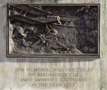 St Saviour's War Memorial, Southwark, Borough High Street, London (detail) © Historic England/DP182991. The stone plinth topped by a crouching bronze infantryman, is decorated with carved reliefs that include a naval battle scene and one of aerial combat. This highly detailed dog fight among the clouds between British and enemy aircraft symbolises a revolution in aerial warfare - fighter aircraft