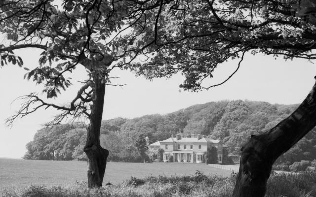 General view of Sheringham Hall across the parkland. c Historic England Archive