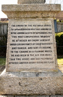 Captain William Leefe Robinson Memorial, Cuffley, Hertfordshire (detail). The inscription includes the words: '…he attacked an enemy airship…and sent it crashing to the ground a flaming wreck…' © Historic England/DP219492 Leefe Robinson was shot down over France 6 April 1917 and taken prisoner-of-war. Repatriated December 1918, he died 31 December 1918 in the global flu pandemic.