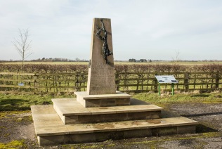 Wickenby RAF Memorial, Wickenby Airport, Lincolnshire. Sculpture by Margarita Wood. ). Dedicated 6 September 1981. Newly listed at Grade II. © Historic England/DP219515 This Second World War memorial - located at the entrance to the airport - commemorates the 1,080 aircrew of 12 and 626 Bomber Command squadrons who lost their lives in bombing raids on Germany and during the liberation of occupied Europe.