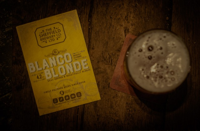 Blanco Blonde label next to a pint of beer
