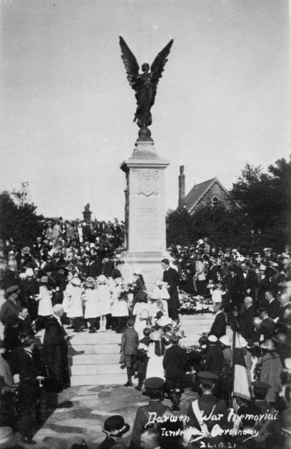 A crowd gathers around Darwen War Memorial at it's unveiling