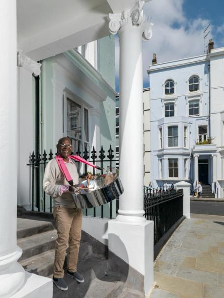 Sterling Betancourt stands in Powis Square with his steeel pan