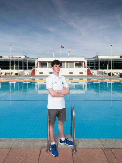 Mitchell Adams, champion swimmer and team captain stood at Uxbridge Lido