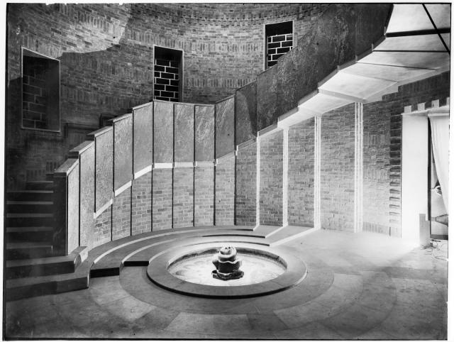 A curved Art Deco staircase made up of rectangular panels