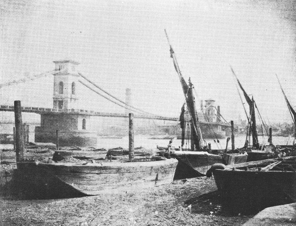 The Hungerford Suspension bridge with boats in the foreground