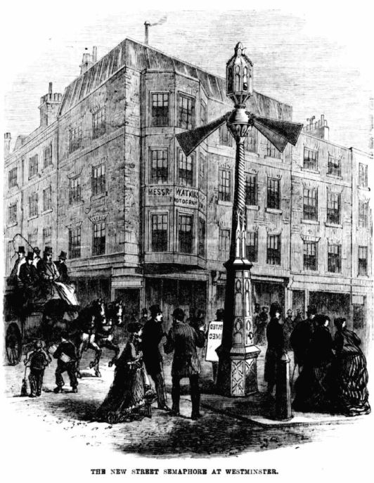Ilustration of a Westminster Street filled with pedestrians and people on a horse-drawn-carriage. In the centre of the image is the world's first traffic light. A caption reads The New Street Semaphore at Westminster
